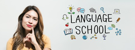 Language school with young woman in a thoughtful fac