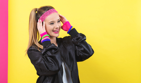 Woman in 1980s fashion theme on a split yellow and pink background