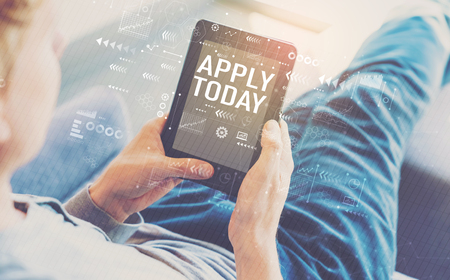 Apply today with man using a tablet in a chair