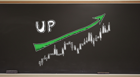 Market up trend chart on a blackboard with erasers