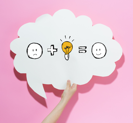 Good idea equals happy with a speech bubble on a pink background