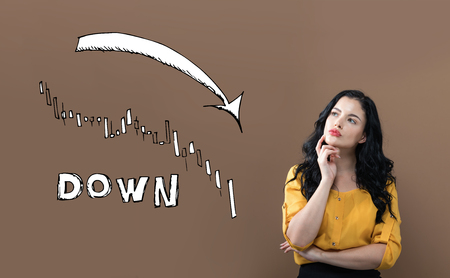 Market down trend chart with young businesswoman on a brown background Stock Photo