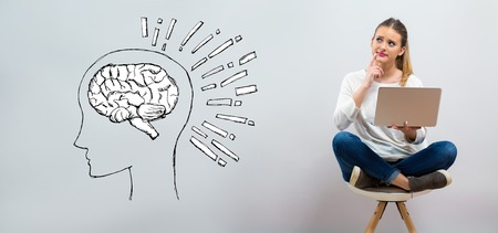 Brain illustration with young woman using her laptop on a grey background