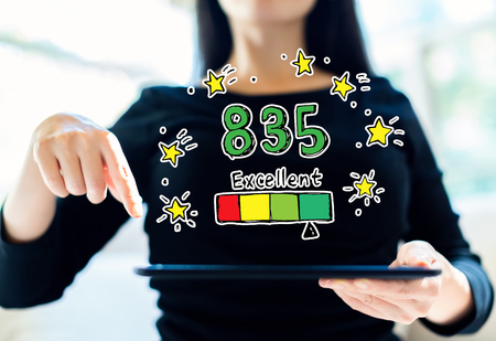 Excellent credit score theme with woman using her tablet