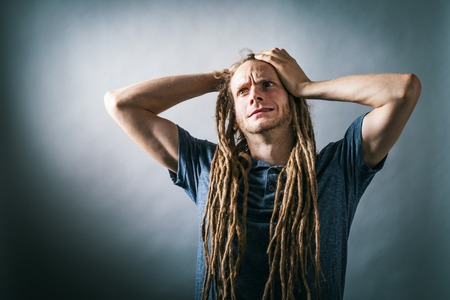 Young man feeling stressed out on a solid background Reklamní fotografie