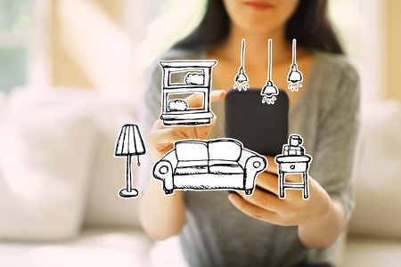 New apartment dream with woman using her smartphone in a living room