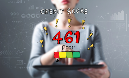 Poor credit score theme with business woman using a tablet computer Stockfoto