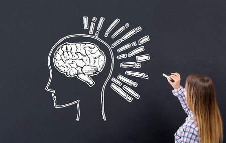 Brain illustration with young woman writing on a blackboard