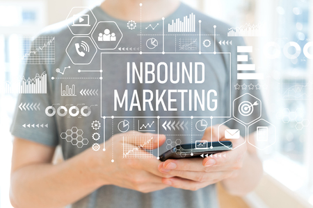 Inbound marketing with young man using a smartphone Banco de Imagens