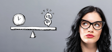 Time and money on the scale with young businesswoman in a thoughtful face