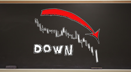 Market down trend chart on a blackboard with erasers 版權商用圖片