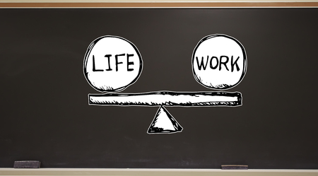 Life and work balance on a blackboard with erasers