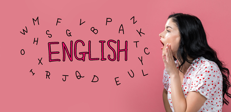 English with alphabets with young woman speaking on a pink background
