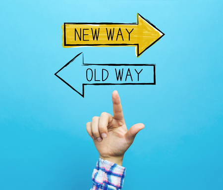 Old way or new way with hand on a blue background