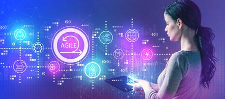 Agile concept with business woman using a tablet computer Banco de Imagens