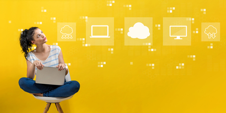 Cloud computing with young woman using a laptop computer Standard-Bild - 116652432