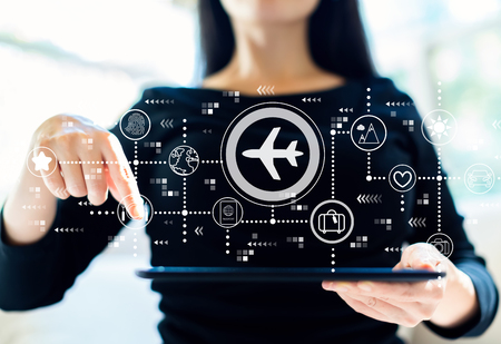 Airplane travel theme with woman using her tablet Standard-Bild - 116652499