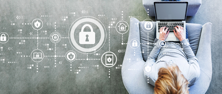 Cyber security with man using a laptop in a modern gray chair Standard-Bild - 116691639