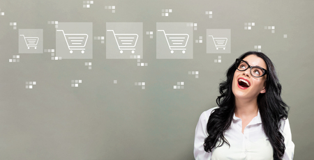 Online shopping theme with young businesswoman in a thoughtful face Standard-Bild - 116701397