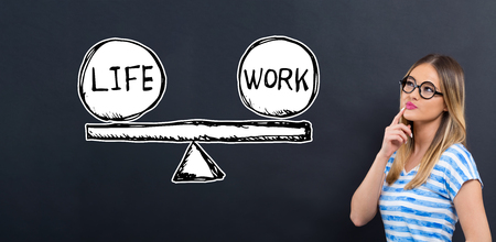 Life and work balance with young woman in front of a blackboard