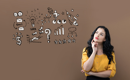 Business strategy ideas with young businesswoman on a brown background Stock Photo