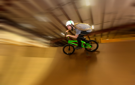 Man jumping and riding on a BMX bicycle at an extreme sports park Stok Fotoğraf