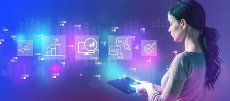 Concept d'échange d'actions avec une femme d'affaires à l'aide d'un ordinateur tablette