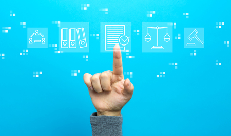 Compliance theme with hand on a blue background Stock Photo