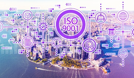 ISO 9001 with aerial view of Manhattan, NY skyline Stock Photo