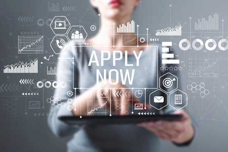 Apply now with business woman using a tablet computer Stockfoto