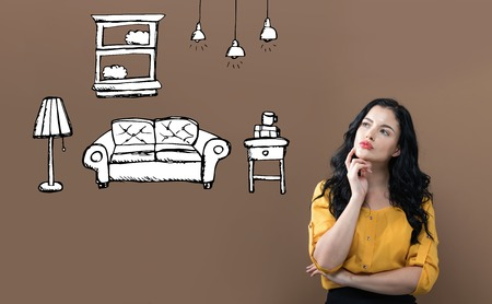 New apartment dream with young businesswoman on a brown background