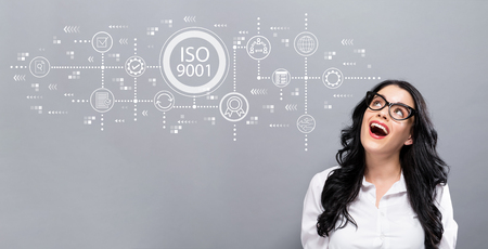 ISO 9001 with young businesswoman in a thoughtful face Stock Photo