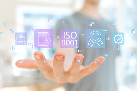 ISO 9001 with young man holding his hand