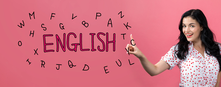 English theme with young woman on a pink background Stock Photo