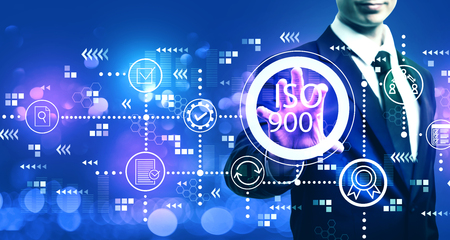 ISO 9001 with businessman on blurred blue light background