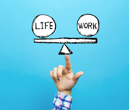 Life and work balance with hand on a blue background Stock fotó