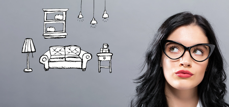 New apartment dream with young businesswoman in a thoughtful face Stock Photo - 117939061