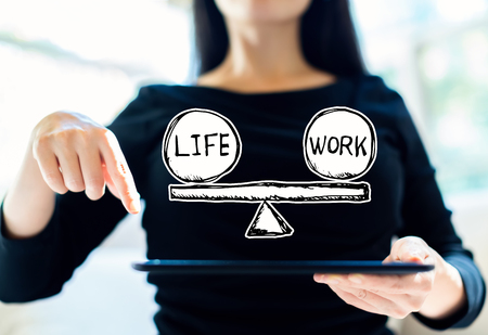 Life and work balance with woman using her tablet Stock Photo