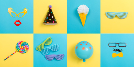 Party theme with celebration accessories on vibrant square titles Reklamní fotografie