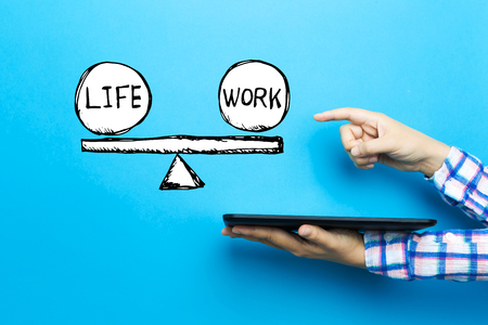 Life and work balance with a tablet computer on a blue background