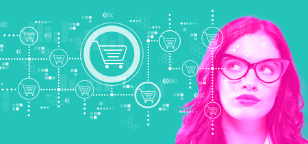 Online shopping theme with young businesswoman in a thoughtful face Stock Photo