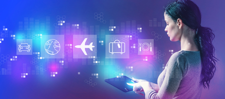 Airplane travel theme with business woman using a tablet computer Stock Photo