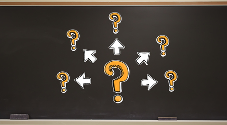 Big and small question marks with arrows on a blackboard with erasers