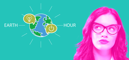 Earth hour with young businesswoman in a thoughtful face Stock Photo
