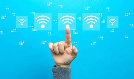 Wifi concept with hand on a blue background