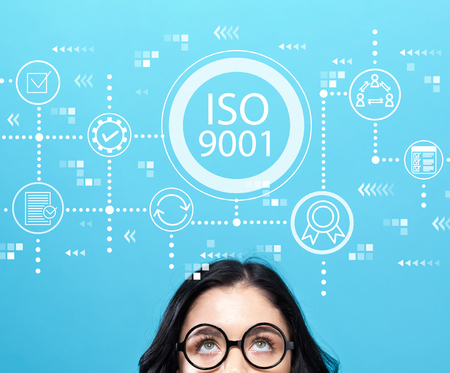 ISO 9001 with young woman wearing eye glasses Stockfoto