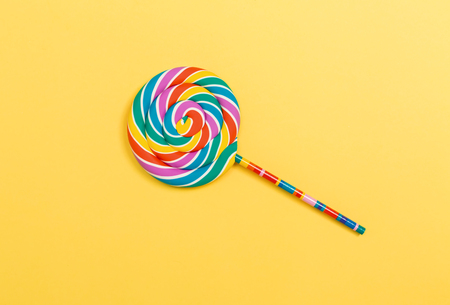 Big lollipop on a yellow paper background