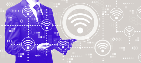 Wifi concept with businessman holding a tablet computer Stock Photo