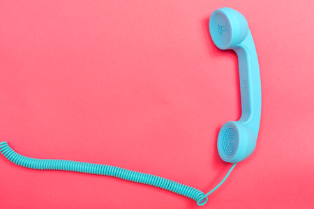 Retro phone on a pink paper background Stock Photo