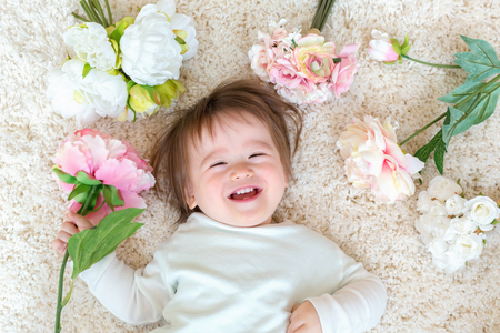 Toddler boy with a bouquet of pretty flowers 写真素材